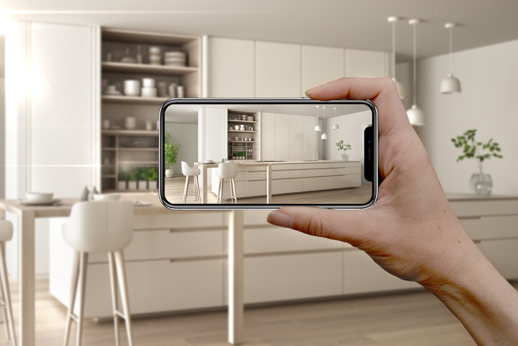 Property manager using smart phone for live online property tour
