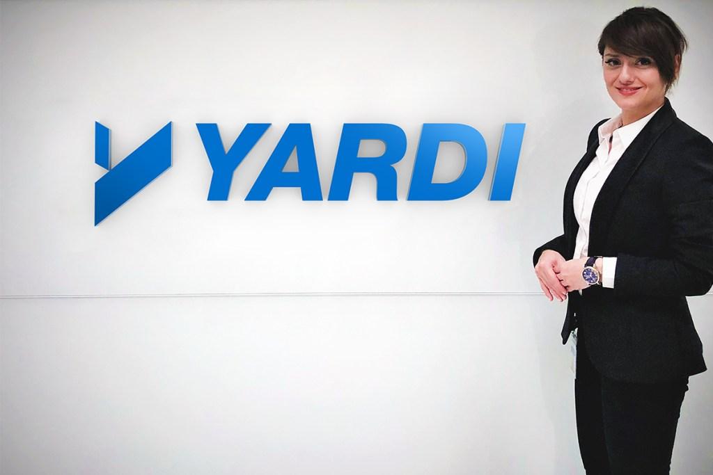 Parisa Vafaei next to Yardi sign